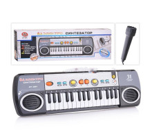 Синтезатор с микрофоном на батарейках, 31 клавиша, размер (44х12х4 см). арт. 0884