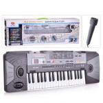 Детский электронный синтезатор пианино с микрофоном +FM радио, от сети и батареек, 37 клавиш, размер 70 x 23 x 8 см арт. 0889